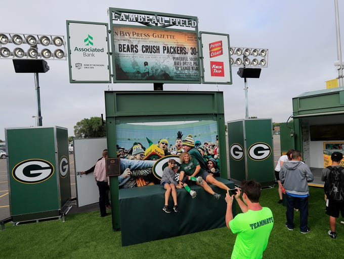 Fans do a Lambeau leap at the Green Bay Packers unveiling