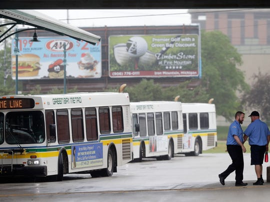 Bus drivers head to their buses at the Green Bay Metro