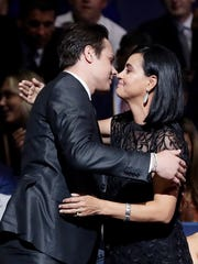 Auston Matthews reaches for his mother Ema Matthews after being selected first overall by the Toronto Maple Leafs.