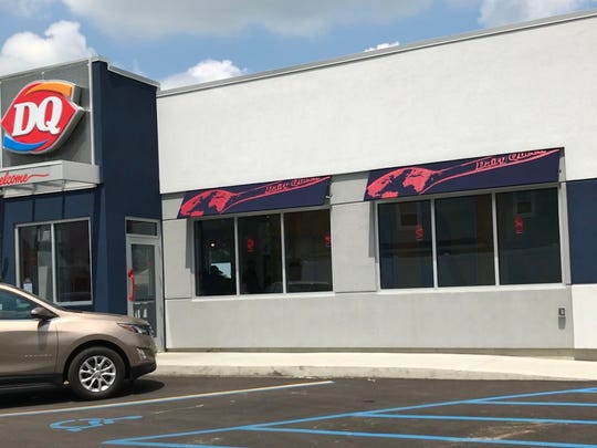 A judge says the owner of a Charlotte Dairy Queen where drive-thru speakers were previously prohibited allowed to install them.