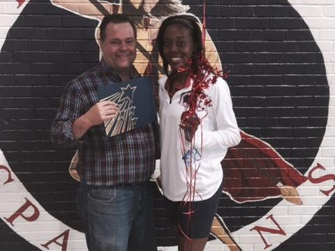 Comeaux High volleyball standout Bria Moore is presented her Female Athlete of the Week Award by Kevin Foote of the Daily Advertiser sports department.