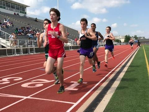 The lead pack of the boys 3,200 meters make their way around the track at the Yellow Jacket Relays at Lee Hedges Stadium on Saturday.