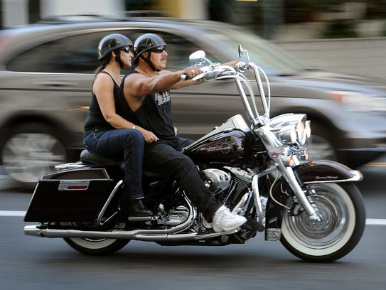 Bikers ride through downtown Reno during a previous