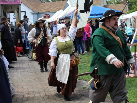 Her Majesty's Musketeers march through the Village Green on their way to their gunpowder demonstration on Saturday afternoon.