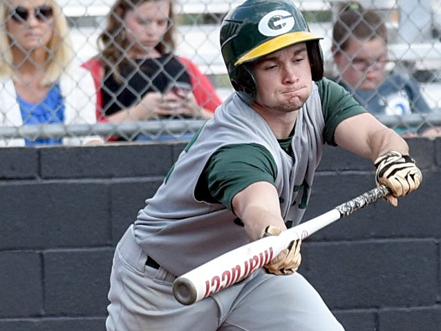 Gallatin High senior Billy Campbell lays down a second-inning bunt.