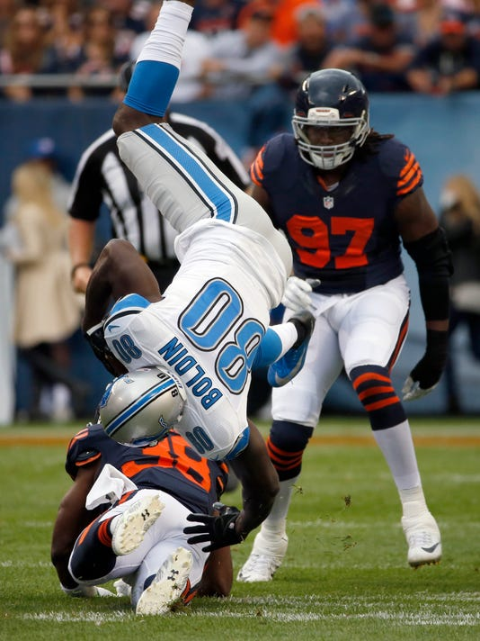 Detroit Lions wide receiver Anquan Boldin (80) flips over in the air as he makes a catch during the first half of an NFL football game against the Chicago Bears, Sunday, Oct. 2, 2016, in Chicago. (AP Photo/Nam Y. Huh)