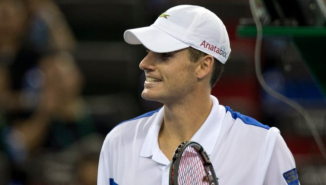 United States' John Isner, shown at the Shanghai Masters, advanced to the third round of the Paris Masters on Wednesday.