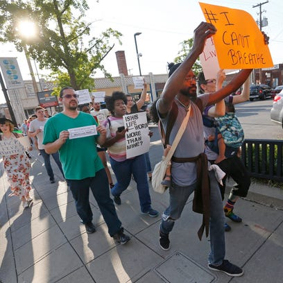 Black Lives Matter protesters Milton Goosby, front