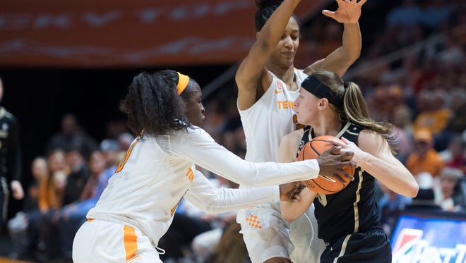 Tennessee's Meme Jackson, left, and Jaime Nared presses Vanderbilt's Rachel Bell on Sunday, January 7, 2018.