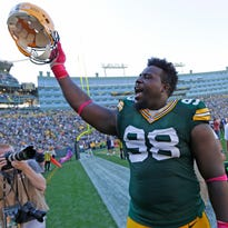Green Bay Packers nose tackle Letroy Guion (98) celebrates after the game against St. Louis Rams at Lambeau Field.
