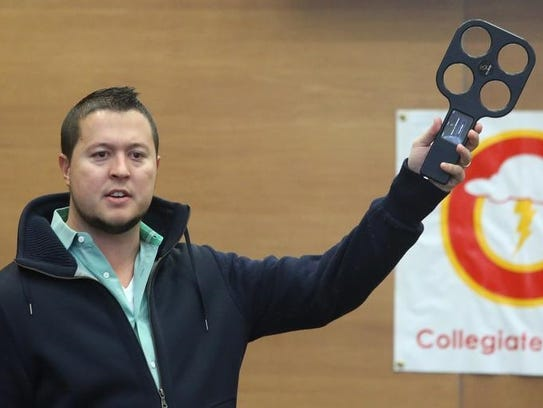 Entrepreneur Ben McDougal holds up a FliteBrite beer