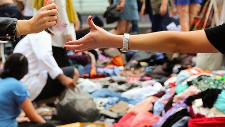 Money changing hands at a flea market.
