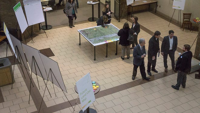 A steady stream of residents and local officials moved through the displays, adding their preferences and thoughts to different types of change in the city,