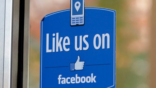 """In this Dec. 13, 2011 file photo, a sign with Facebook's """"Like"""" logo is posted at Facebook headquarters near the office for the company's User Operations Safety Team in Menlo Park, Calif."""