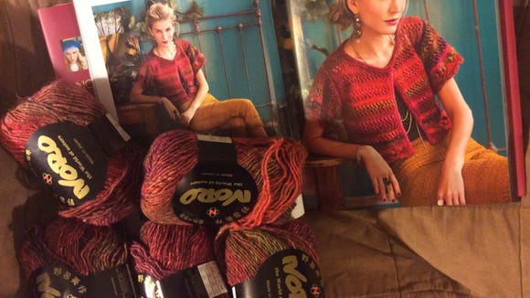 Mom wants this Cropped Cardigan from the Noro Lace book, and she wants it in the same colors.