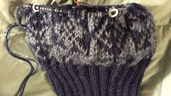 This is the hat I'm making for John. The colors are a little bluer in real life.