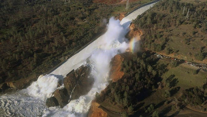 This aerial photo released by the California Department of Water Resources shows the damaged spillway with eroded hillside in Oroville, Calif.