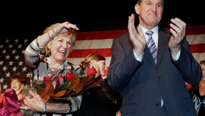 U.S. Sen. Joe Manchin, D-W.Va., and his wife Gayle thank supporters at his campaign celebration in Fairmont, W.Va., Nov. 6, 2012. Manchin defeated Republican challenger John Raese.