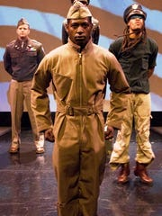 "Royce Johnson (center) with Jeremiah Wiggins (left) and Omar Edwards starred in ""Fly"" at Crossroads in 2009."