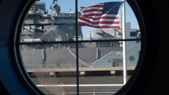 A view of the Battleship New Jersey Museum is shown through a window along the pier.