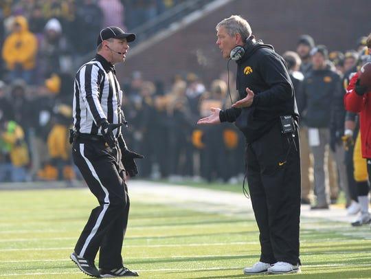 Kirk Ferentz argues a fourth-quarter call against Nebraska.