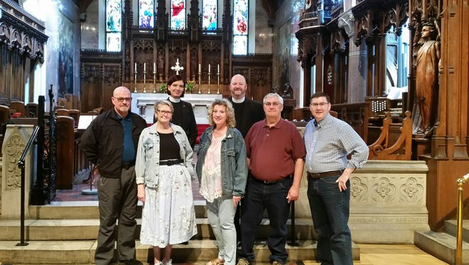 The POP Spirit Bluegrass Band will perform at 2 p.m. on Sunday, May 20, at the Cathedral of St. Paul, benefiting the group and Broken Bread. Pictured are, from left: Deacon Mike Hackbarth; Lucy Sumner, director of Broken Bread; the Rev. Canon Ezgi Saribay Perkins; Colleen Perrine, director of POP Spirit; the Very Reverend Dean Perkins; Charlie Sosinski, musician from Fond du Lac; and Joseph Lindsay, Cathedral organist.
