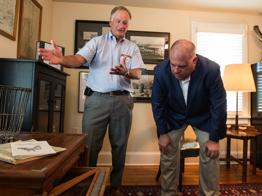 Perdue Farms chairman, Jim Perdue and Maryland Governor Larry Hogan observe an antique chicken incubator at the Perdue Family Farmhouse on Monday, Aug. 21, 2017.