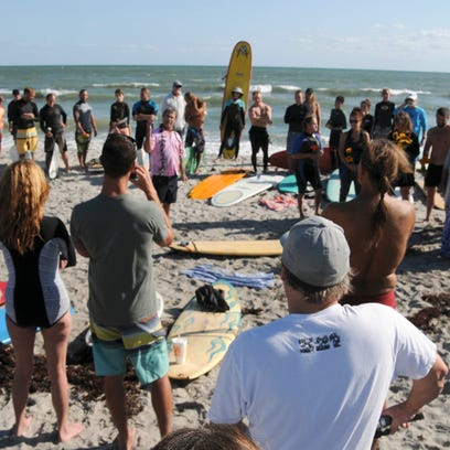 Friends and family of Dana Brown gather on the beach