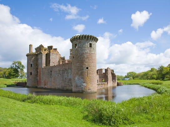 A stone castle surrounded by a moat.