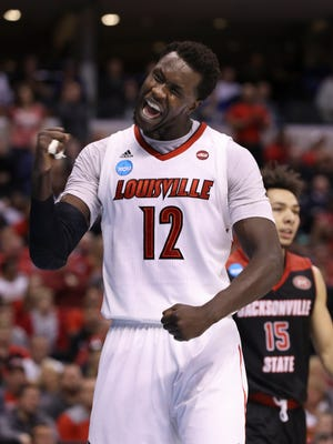 U of L's Mangok Mathiang (12) celebrates the score and foul against Jacksonville State during the NCAA tournament at the Bankers Life Fieldhouse in Indianapolis.Mar. 17, 2017