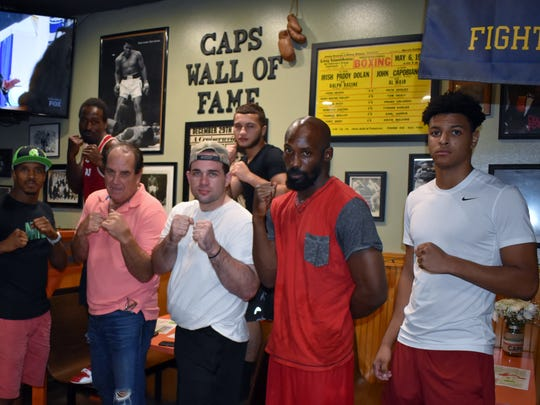 "Ruben Bermudez, Chris Gray, John ""Cap"" Capobianco, Rick Curran, Courtney Jones, Cassius Koht, Jesse C. Peacock Dr. and Casa Abusalhu strike a pose after a training session."