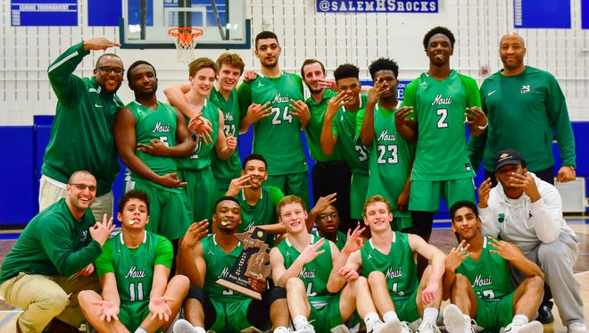 The Novi Wildcats made it three boys basketball district titles in a row with a 74-56 win over Northville.