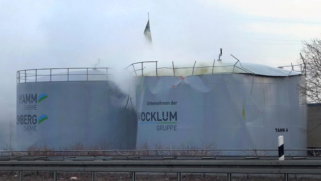 Sulfuric acid leaks out of a tank in Oberhausen, Germany, Thursday, Feb. 16 2017.