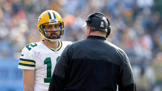 Green Bay Packers quarterback Aaron Rodgers (12) and head coach Mike McCarthy try to get the offense going during the Green Bay Packers 47-25 loss to the Tennessee Titans at Nissan Stadium in Nashville, Tenn.