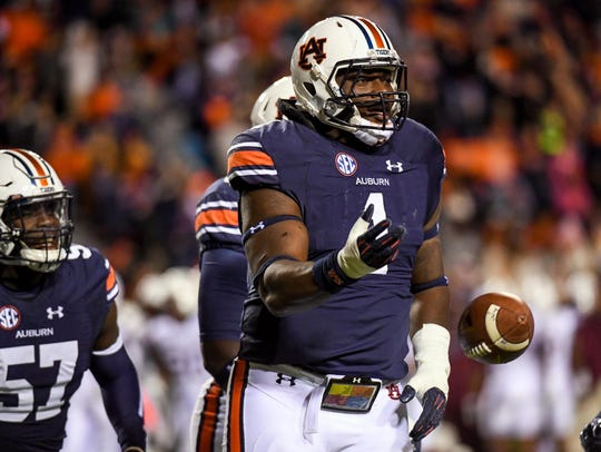 Auburn defensive tackle Montravius Adams celebrates