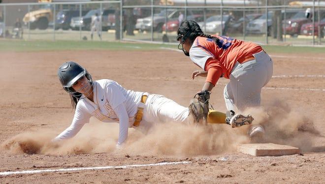Eastlake third baseman Kasey Flores tags out Parkland's Jae-Lynn Bryant during their game Saturday morning at Parkland High School. Eastlake beat the Matadors 10-0.
