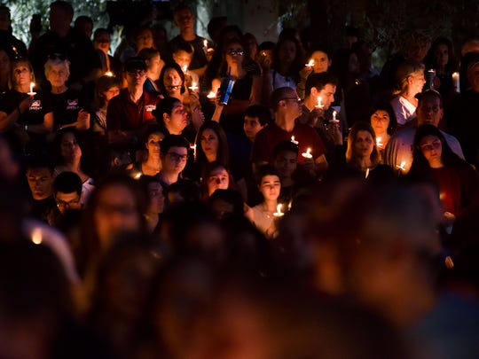 Thousands of grieving students, family members and