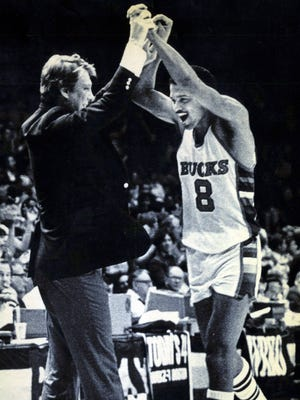 Bucks coach Don Nelson and Marques Johnson are fired up after beating the Boston Celtics in the 1983 NBA playoffs.