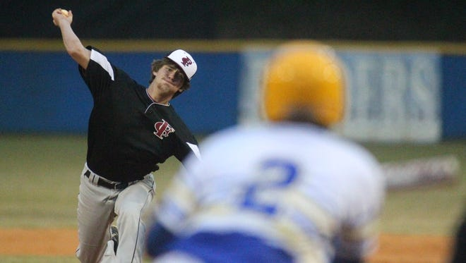 Franklin County's Christopher Newell pitches against Rickards.