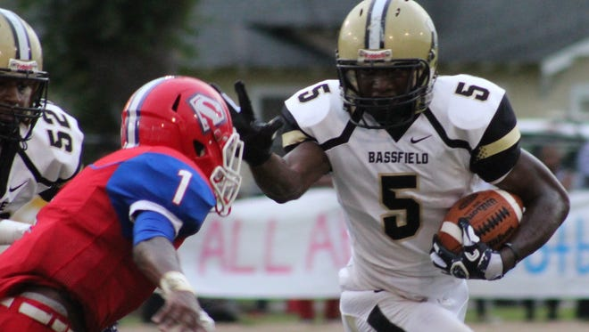 Bassfield quarterback Cason Sims tries to stiffarm a Seminary defender during Friday's game.