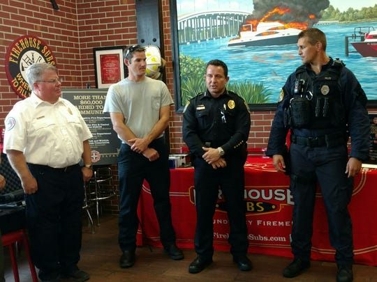 Cape Coral Police Chief Dave Newlan, third from left, talks about the emergency kits his department received courtesy of Firehouse Subs.