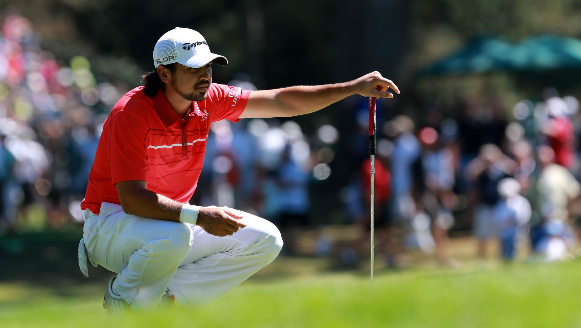 Jason Day lines up a putt at No. 3.