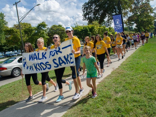 The Port Huron Northern volleyball team leads the walk Sunday, Sept. 18, 2016, during the annual Walk for Kids' Sake in Port Huron.
