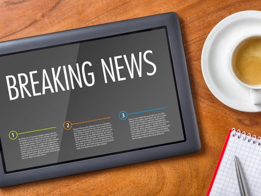 Tablet on a wooden desk - Breaking News
