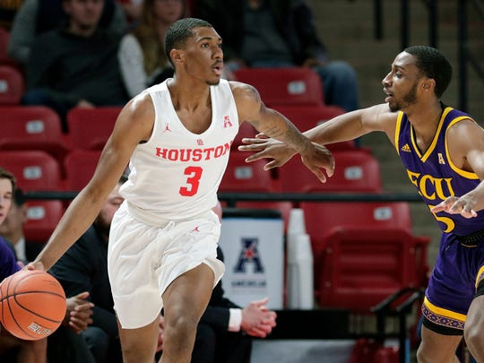 Houston guard Armoni Brooks (3) looks for a way around East Carolina guard Tyler Foster (5) during the first half of an NCAA college basketball game Wednesday, Jan. 23, 2019, in Houston. (AP Photo/Michael Wyke)