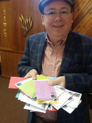 David Abrams, the president of Shomrei Torah, holds letters of support.