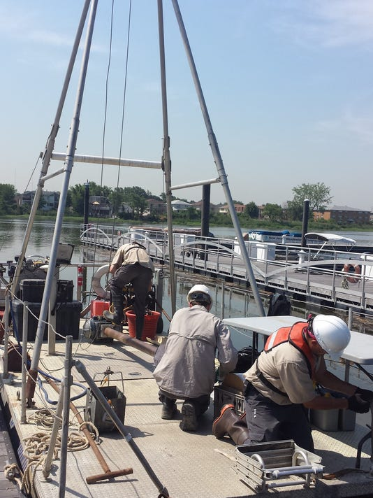 Collecting sediment core samples on the Hackensack River