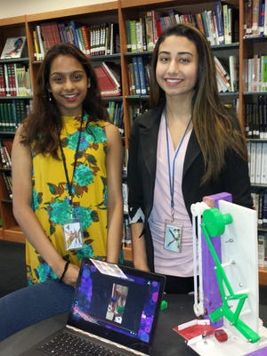 "Edison Academy seniors Abinaya Sivakumar of Edison, left, and Avneet Randhawa of Monroe produced a ""two-plane rotational mechanism"" powered by a hand crank."