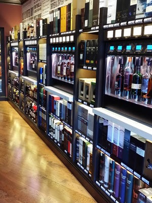 Grane offers hundreds of whiskeys, many of which customers can sample before buying. It's the second self-serve brand launched by Allouez native Dan Matuszek.