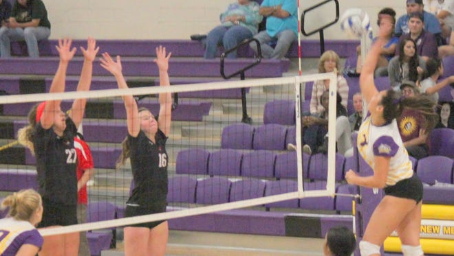 Danny Udero/Sun-News: Western's Kelli McGhiey smashes the ball during second set action against Western State College. The Lady Mustangs swept the Lady Mountaineers to go to 2-0 in the conference.